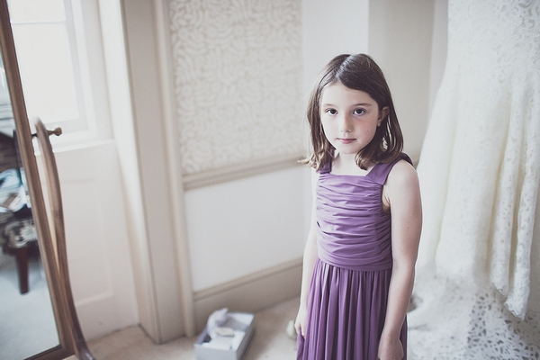 Flower girl in purple dress