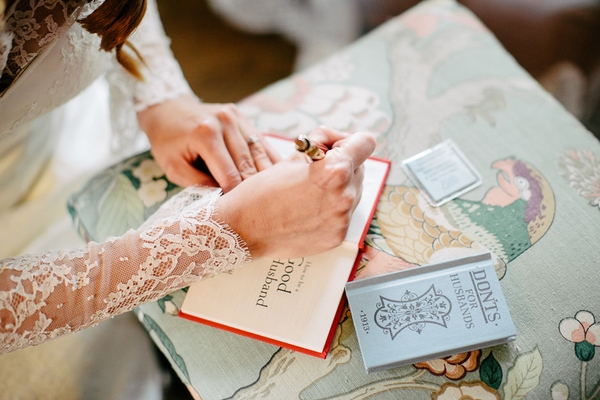 Bride writing in book