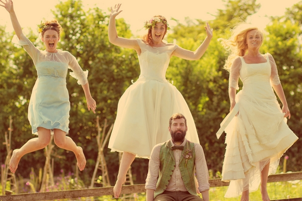 Vintage groom with brides jumping