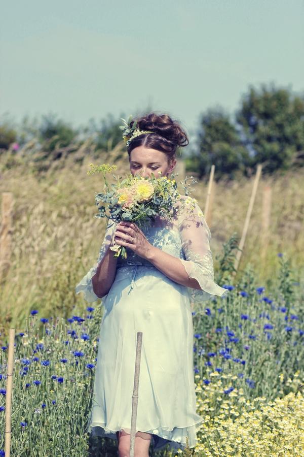 Vintage bride smelling bouquet
