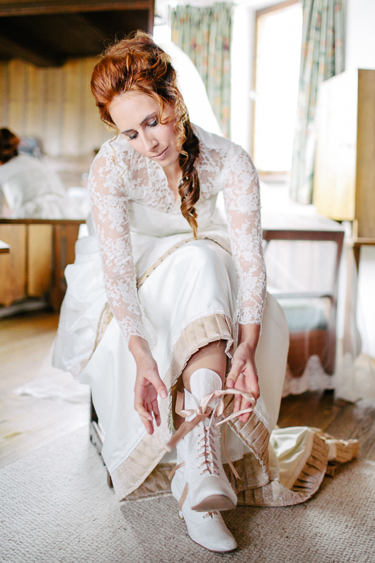Bride doing up boots