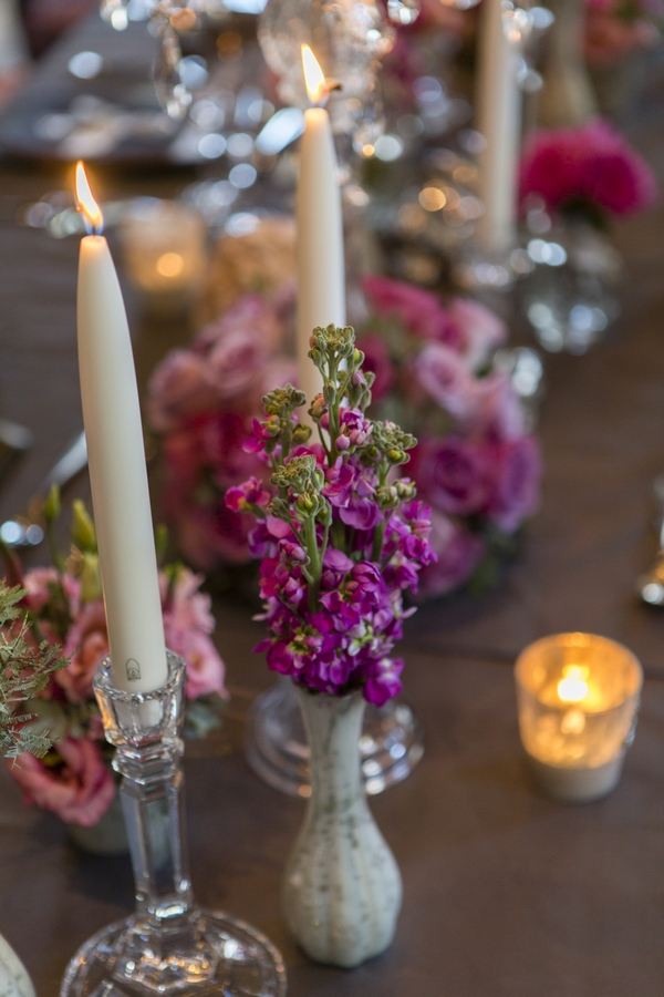 Candles and wedding table flowers