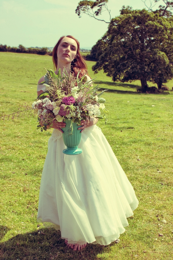 Vintage bride with vase of flowers