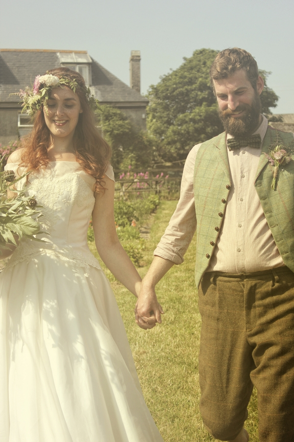 Vintage bride and groom holding hands