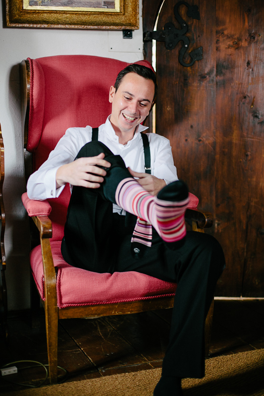 Groom pulling up sock