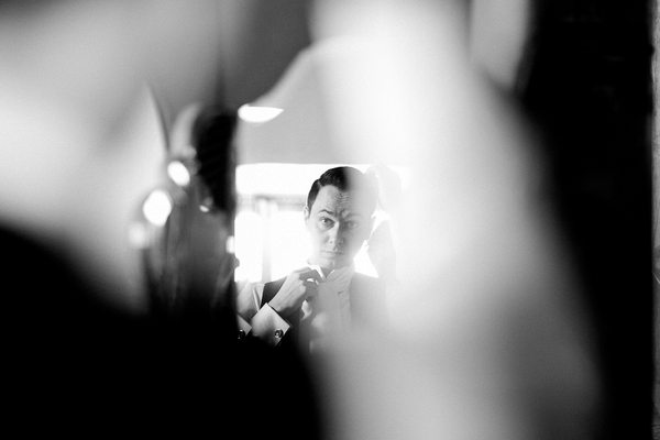 Groom's reflection in mirror