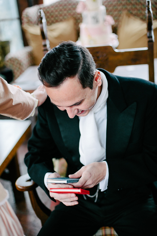 Groom looking at books