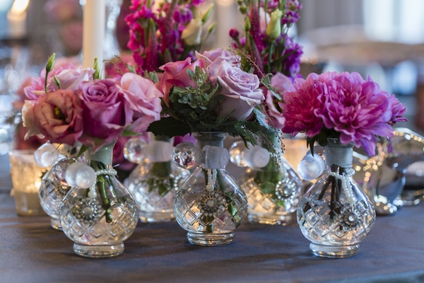 Glass vases of wedding table flowers