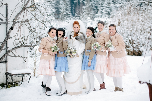 Bride with bridesmaids in snow