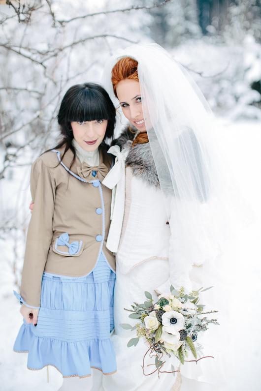 Bride and bridesmaid in snow