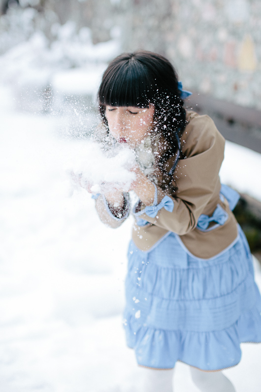 Bridesmaid blowing snow