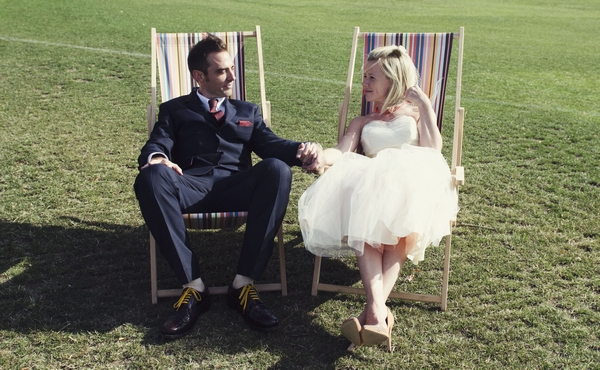 Bride and groom on deck chairs