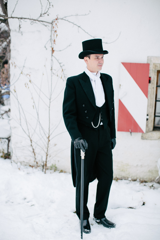 Groom with cane in snow