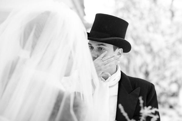 Groom wiping away tear