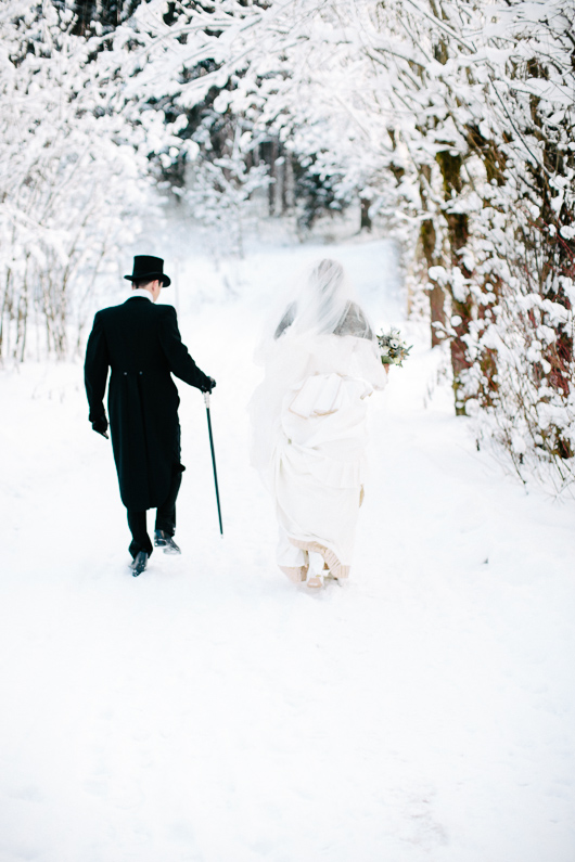 Bride and groom walking in snow