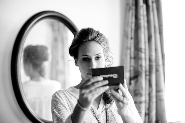 Bride looking at make-up in mirror
