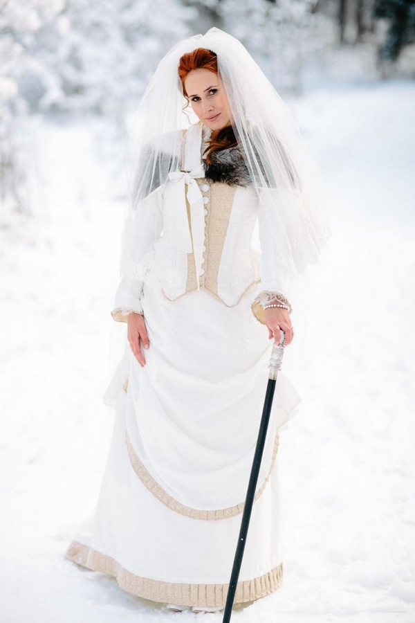 Bride in snow with groom's cane