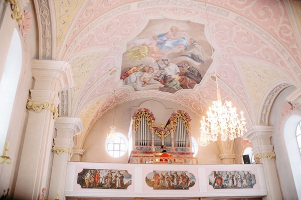Church organ and ceiling with painting