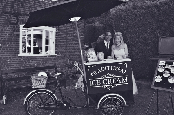 Bride and groom by ice cream cart