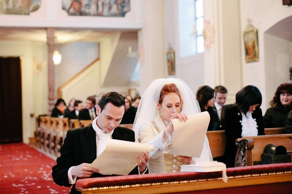 Bride and groom reading order of service