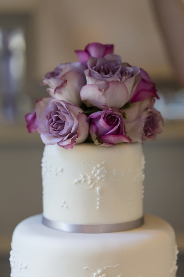 Flowers on top of wedding cake