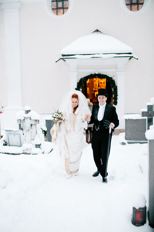 Bride and groom leave church in snow