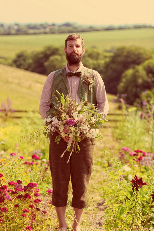 Vintage groom holding bouquet