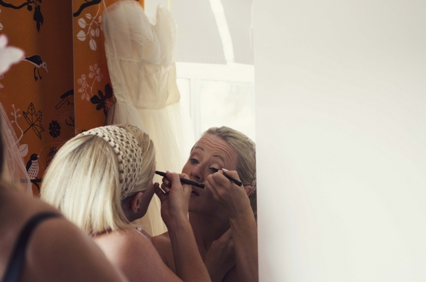 Bride doing make-up