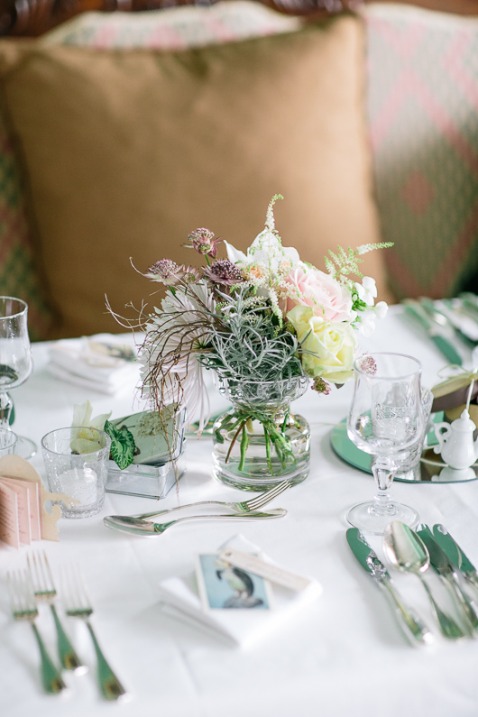 Small vase of flowers on wedding table