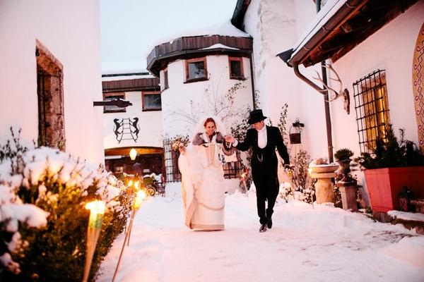 Bride and groom walking in snow