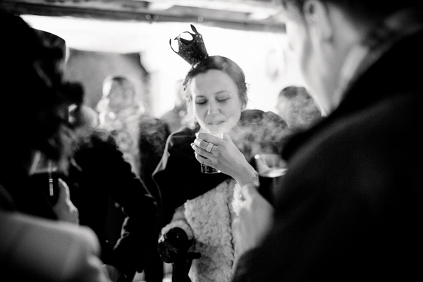 Wedding guest with hot drink