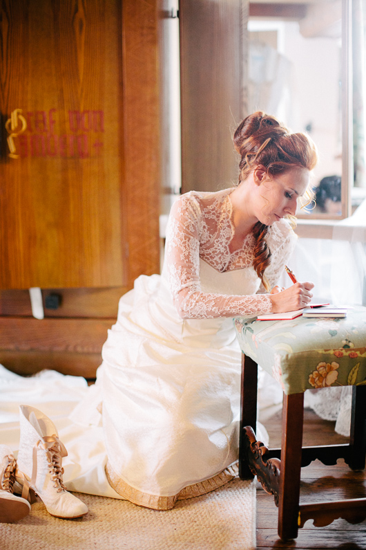 Bride writing message in book