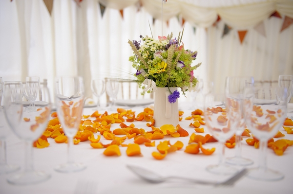 Orange confetti on wedding table