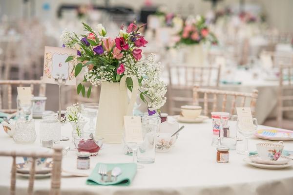 Jug of flowers on wedding table