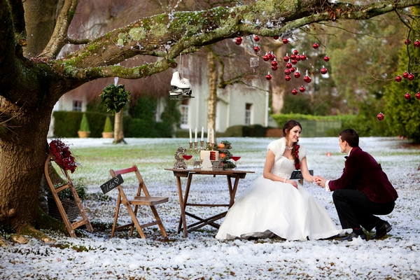 Bride and groom at table outside in snow