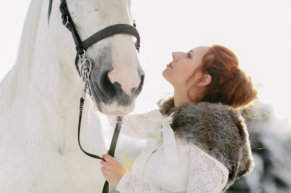 Bride looking up at horse