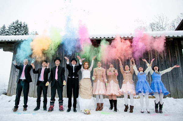 Bridal party throwing colourful holi powder in the air