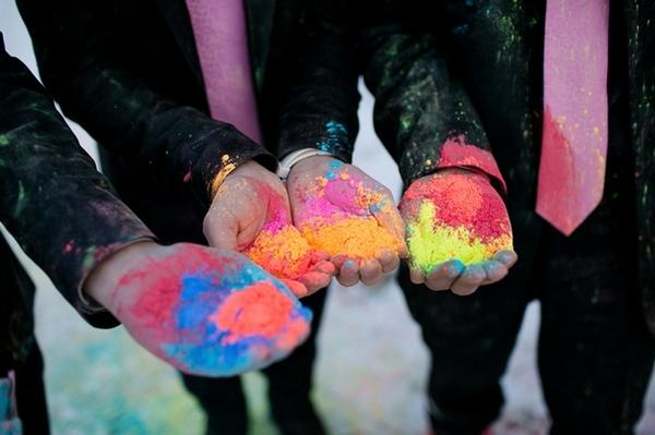 Groomsmen's hands full of holi powder