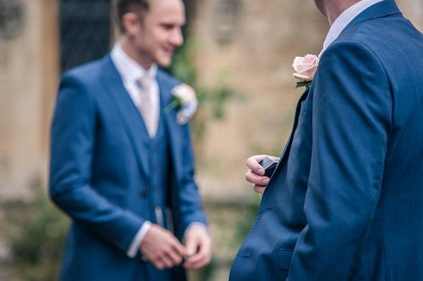 Best man holding wedding ring box