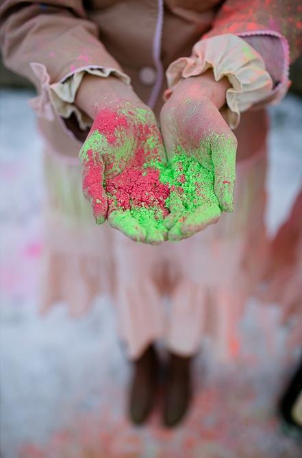 Bridesmaid holding holi powder