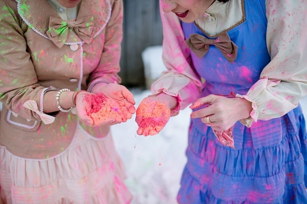 Bridesmaids holding holi powder