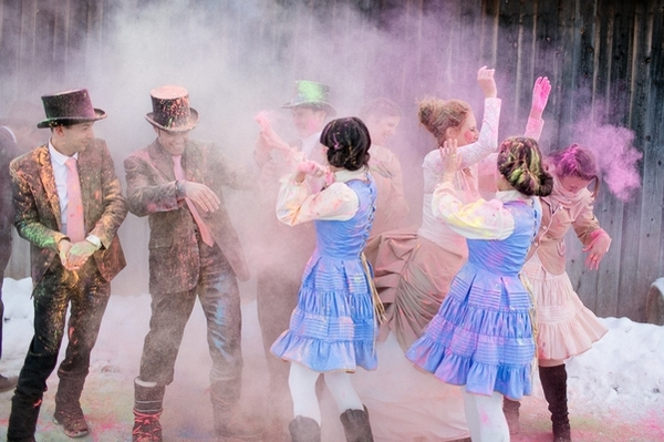 Bridal party throwing holi powder at each other
