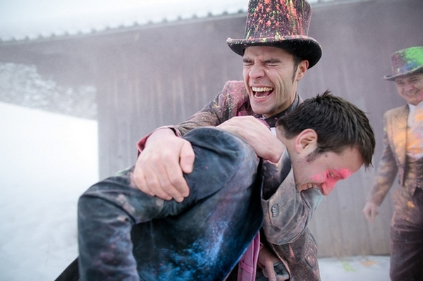Groomsmen hugging covered in holi powder