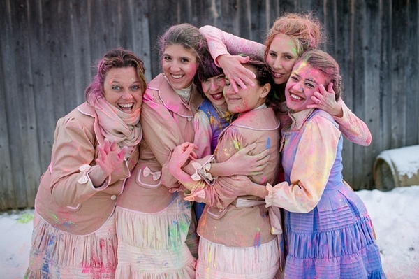 Bridesmaids covered in holi powder