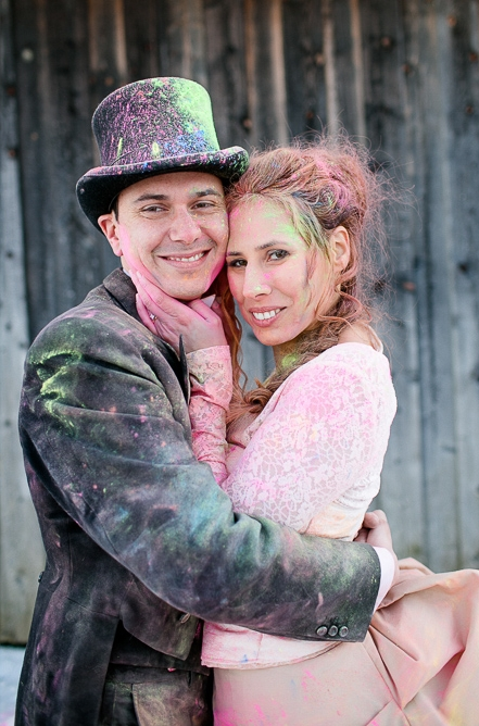Bride and groom covered in holi powder