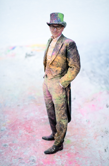 Groom covered in holi powder