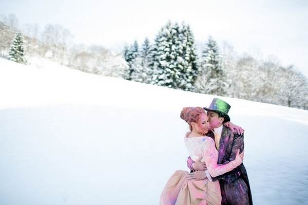 Bride and groom covered in holi powder in the snow
