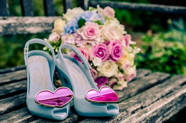 Blue bridal shoes and bouquet