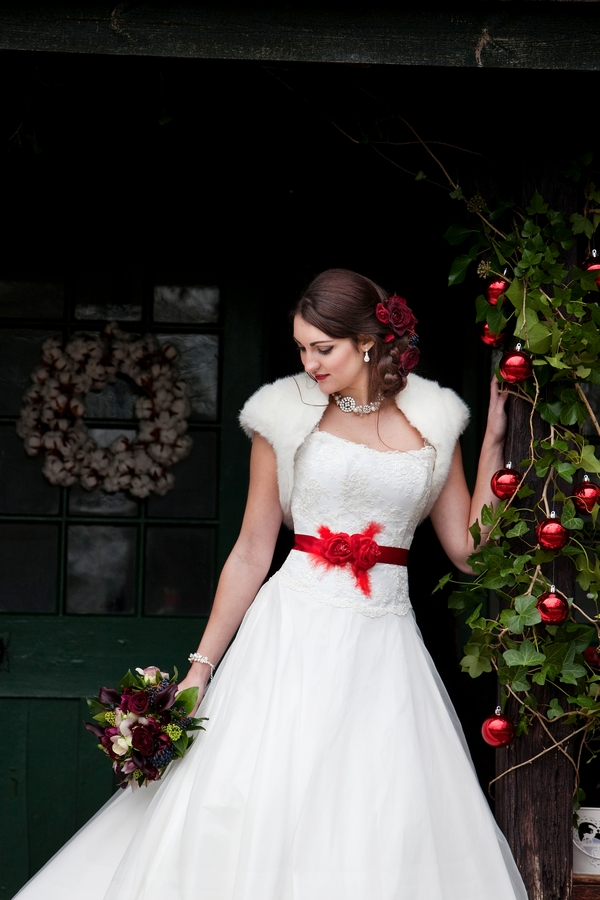 Bride with red bow on wedding dress