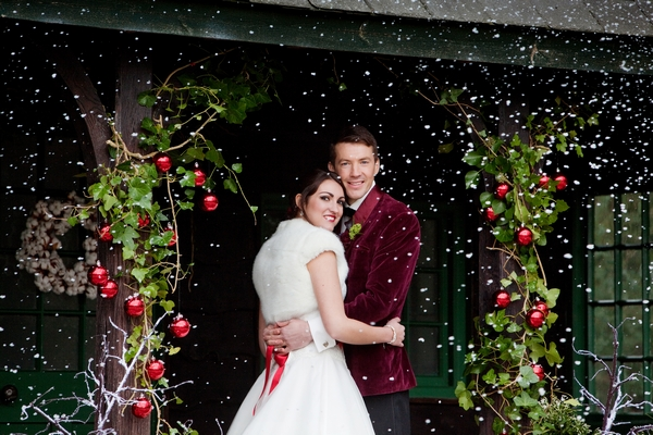 Bride and groom with snow